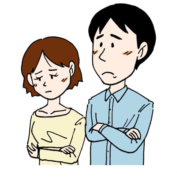 腕を組んで困った顔をしている若い男女夫婦イラスト